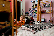 Haley Berg, 15, texts with friends in her bedroom in Celina, Texas on January 23, 2014. Berg, a freshman at Celina High School, began receiving attention from top collegiate soccer programs when she was 13 and has already committed to the University of Texas. (Cooper Neill / for The New York Times)