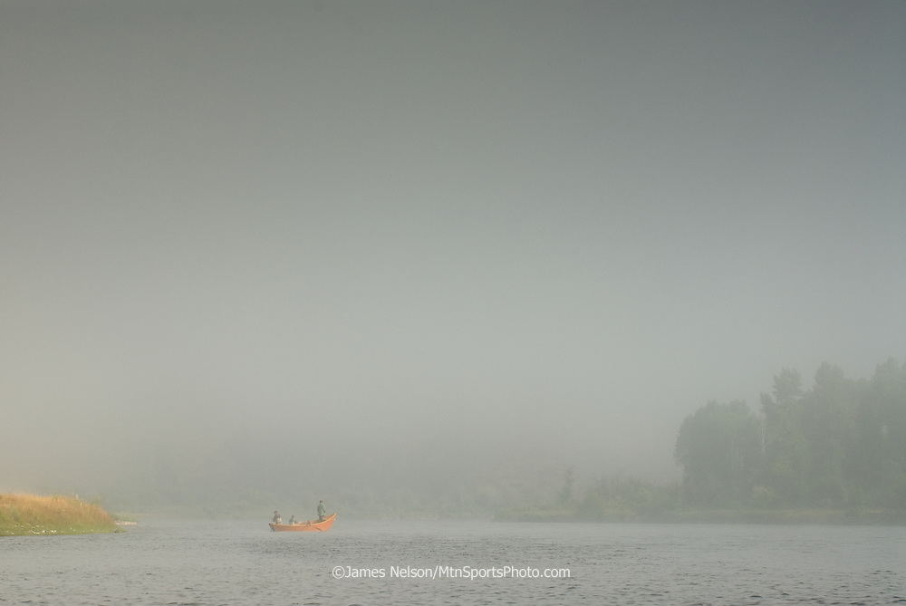 Anglers cast flies for trout during a foggy morning on the South Fork of the Snake River, Idaho.