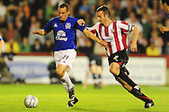 London - Tuesday, 21st September, 2010: Kevin O'Conner of Brentford and Leon Osman of Everton during the Carling Cup 3rd Round match at Griffin Park, London...Pic by: Alex Broadway/Focus Images