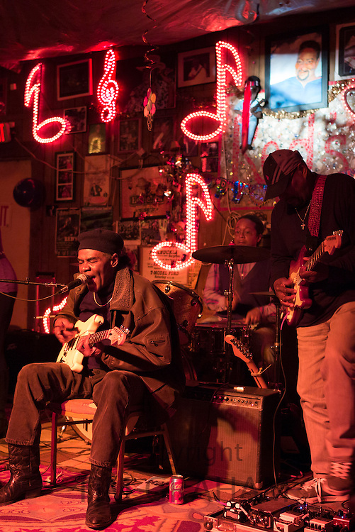 Blues band, guitarist, drums, vocals in live performance on stage at Red's Lounge Blues Club in Clarksdale, Mississippi, USA