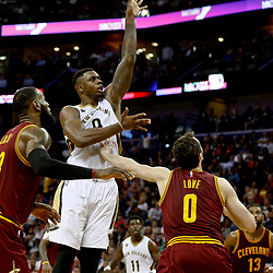 Jan 23, 2017; New Orleans, LA, USA; New Orleans Pelicans forward Terrence Jones (9) shoots over Cleveland Cavaliers forward LeBron James (23) and forward Kevin Love (0) during the second half of a game at the Smoothie King Center. The Pelicans defeated the Cavaliers 124-122. Mandatory Credit: Derick E. Hingle-USA TODAY Sports