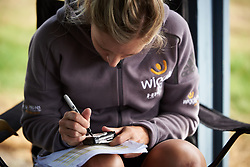 Annette Edmondson (AUS) writes her stem notes for Ladies Tour of Norway 2018 Stage 3. A 154 km road race from Svinesund to Halden, Norway on August 19, 2018. Photo by Sean Robinson/velofocus.com