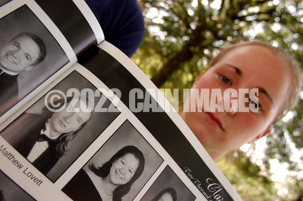 COLLINGSWOOD, NJ - JULY 7: Matthew Lovett (2nd from L) is seen in a Collingswood High School yearbook held by classmate Kate Kline (R) July 7, 2003 outside Collingswood High School, in Collingswood, New Jersey. Matthew Lovett and two juveniles are charged with conspiracy to commit mass murder after they were caught at about 4am July 6, 2003 with various weapons. Kline said they can't defend his actions, she never had a problem with Lovett, and that he was a good person. (Photo by William Thomas Cain/Getty Images)