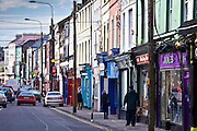 Brightly coloured shops in High Street in popular tourist town of Youghal, County Cork, Ireland