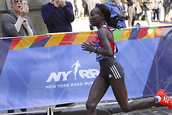 November 6, 2016 - New York, New York, U.S - MARY KEITANY, age 34, of Kenya-- seen here running west on 59th Street in Manhattan-- competes in the New York City Marathon, where she would win the women's division of the race for the third consecutive time. She crossed the finish line in .2:24:26. (Credit Image: © Staton Rabin via ZUMA Wire)