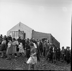 Between 50.000 and 60.000 pilgrims, young and old, from all parts of Ireland and abroad, climbed the rugged slopes of Croagh Patrick to take part in the annual pilgrimage.  Pilgrims reach the newly enlarged oratory on top of Croagh Patrick.<br /> <br /> 29th July 1962