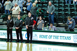 BLOOMINGTON, IL - December 15: Amanda Went, Kelly Hill, Matthew Hanley and part of the IWU women's basketball bench crew during a college women's basketball game between the IWU Titans  and the Carroll Pioneers on December 15 2018 at Shirk Center in Bloomington, IL. (Photo by Alan Look)