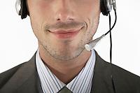 Businessman wearing headset close-up portrait