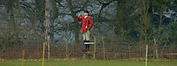 Fox Hunting.Binfield heath, Oxfordshire, England, February 7th, 2005 - Vale of Aylesbury with Garth and south hunt, Siniour joint Master Alan hill, calling (blowing the hunting horn) hounds to keep them together.