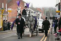 © Licensed to London News Pictures. 18/01/2015. Measham, Leicestershire, UK. The scene outside St Laurence's Church in the centre of Measham for the service of Kayleigh Haywood. The funeral procession makes it's way up the high street in Measham. Photo credit : Dave Warren/LNP