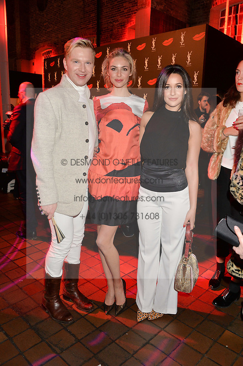 Left to right, HENRY CONWAY, TAMSIN EGERTON and ROXIE NAFOUSI at the YSL Beauty: YSL Loves Your Lips party held at The Boiler House,The Old Truman Brewery, Brick Lane,London on 20th January 2015.