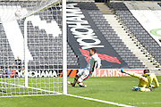 Nicky Maynard scores during the Sky Bet Championship match between Milton Keynes Dons and Brentford at stadium:mk, Milton Keynes, England on 23 April 2016. Photo by Dennis Goodwin.
