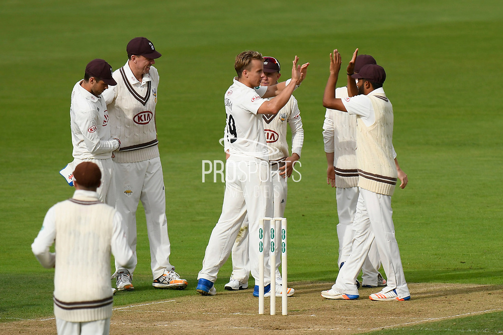 Wicket - Tom Curran of Surrey celebrates taking the wicket of Jimmy Adams of Hampshire during the Specsavers County Champ Div 1 match between Hampshire County Cricket Club and Surrey County Cricket Club at the Ageas Bowl, Southampton, United Kingdom on 6 September 2017. Photo by Graham Hunt.