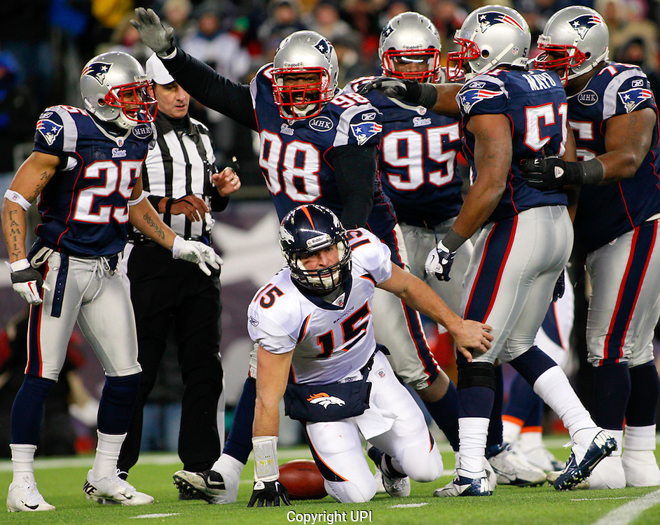 New England Patriots defensive lineman Gerard Warren (98) celebrates after he sacked Denver Broncos quarterback Tim Tebow (15) in the second quarter of the AFC divisional playoff game at Gillette Stadium in Foxboro, Massachusetts on January 14, 2012.    UPI/Matthew Healey
