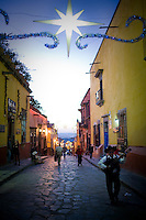 A guitar playing Mariache strolls toward the City Center Plaza in San Miguel de Allende, Mexico, on December 24, 2008.