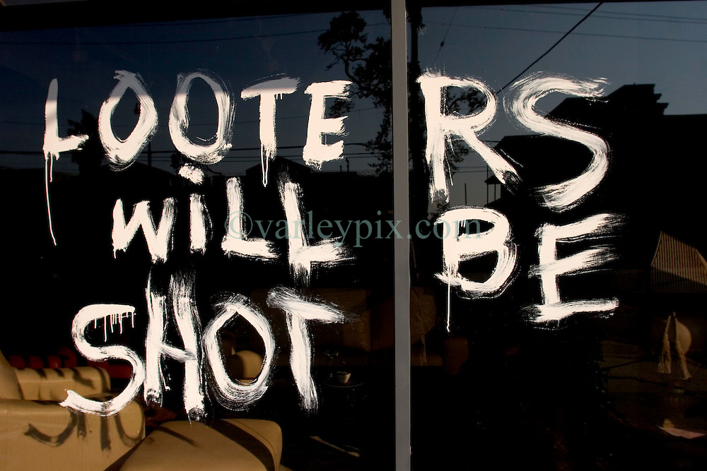 21 Sept 2005. New Orleans, Louisiana.  Hurricane Katrina aftermath.<br /> Looters will be shot sign in a shop window on St Charles Ave in New Orleans. 'Looters will be shot.'<br /> Photo; &copy;Charlie Varley/varleypix.com