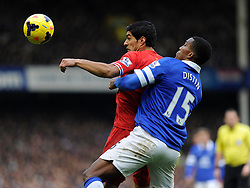 Liverpool's Luis Suarez looks to control the ball under pressure from Everton's Sylvain Distin - Photo mandatory by-line: Dougie Allward/JMP - Tel: Mobile: 07966 386802 23/11/2013 - SPORT - Football - Liverpool - Merseyside derby - Goodison Park - Everton v Liverpool - Barclays Premier League