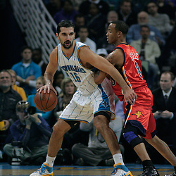 30 January 2009:  New Orleans Hornets forward Peja Stojakovic (16) is defended by Golden State Warriors guard Monta Ellis (8) during a 91-87 loss by the New Orleans Hornets to Golden State Warriors at the New Orleans Arena in New Orleans, LA.