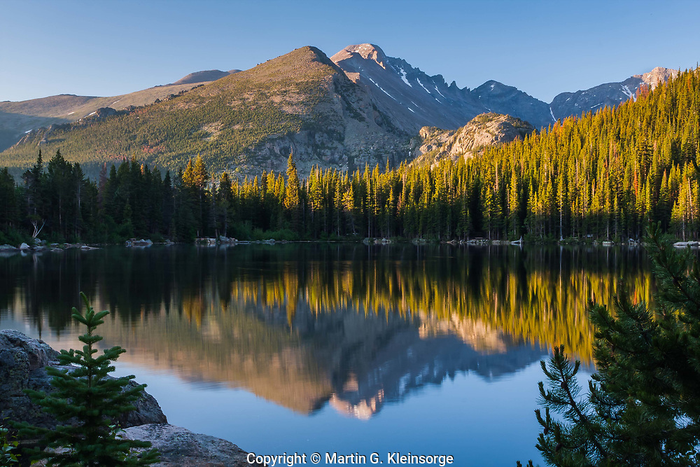 Reflections of Longs Peak in Bear Lake at sunrise.  Rocky Mountain National Park, CO.