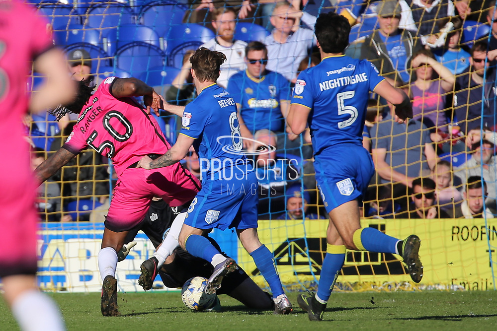 AFC Wimbledon goalkeeper James Shea (1) saving from Southend United striker Nile Ranger (50) during the EFL Sky Bet League 1 match between AFC Wimbledon and Southend United at the Cherry Red Records Stadium, Kingston, England on 25 March 2017. Photo by Matthew Redman.