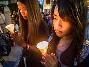 24 AUGUST 2015 - BANGKOK, THAILAND:     Women pray for victims of the Erawan Shrine bombing. One week after the a bomb at the Erawan Shrine in the center of Bangkok killed dozens and hospitalized scores of people, police have not made any arrests. Police bomb sniffing dogs have been deployed to malls and markets around Bangkok. There was a large memorial service sponsored by businesses close the bomb site Monday evening.     PHOTO BY JACK KURTZ