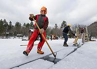 David White and John Jurczynski( feed ice blocks up to Bruce Whitmore during day one of the annual three day ice harvest at Rockywald Deephaven Camp on Squam Lake Wednesday.  Karen Bobotas/for the Laconia Daily Sun)