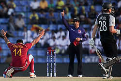 © Licensed to London News Pictures. 01/10/2012. West Indian Ravi Rampaul celebrates as umpire Asad Rauf gives out Rob Nicol during the T20 Cricket World super 8's match between New Zealand Vs West Indies at the Pallekele International Stadium Cricket Stadium, Pallekele. Photo credit : Asanka Brendon Ratnayake/LNP