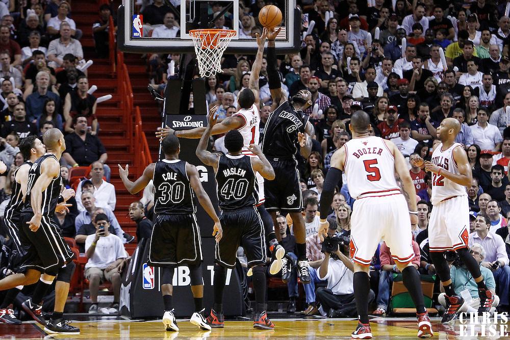29 January 2012: Miami Heat small forward LeBron James (6) blocks Chicago Bulls point guard Derrick Rose (1) during the Miami Heat 97-93 victory over the Chicago Bulls at the AmericanAirlines Arena, Miami, Florida, USA.