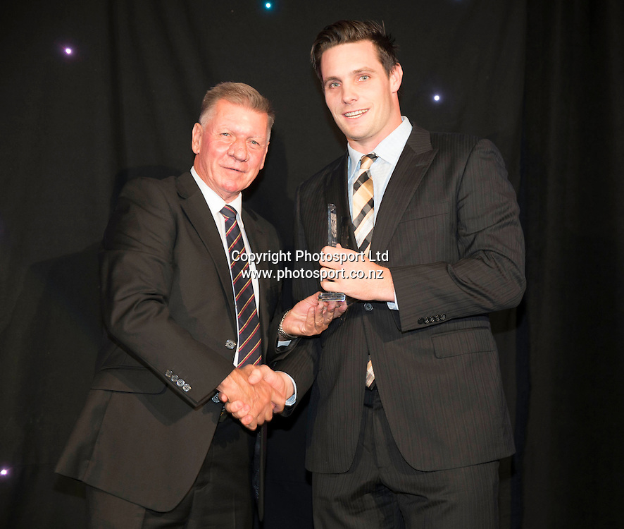 International Cricketer of the year Mitchell McClenaghan with Auckland Cricket president Austin Parsons at the Cricketer of the Year Awards Dinner 2014 held by Auckland Cricket at Eden Park on the 15 April 2014. <br /> Credit; Peter Meecham/ www.photosport.co.nz