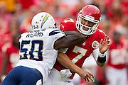 KANSAS CITY, MO - SEPTEMBER 30: Matt Cassel #7 of the Kansas City Chiefs is hit after throwing a pass by Demorrio Williams #58 of the San Diego Chargers at Arrowhead Stadium on September 30, 2012 in Kansas City, Missouri.  The Chargers defeated the Chiefs 37-20.  (Photo by Wesley Hitt/Getty Images) *** Local Caption *** Matt Cassel; Demorrio Williams Sports photography by Wesley Hitt photography with images from the NFL, NCAA and Arkansas Razorbacks.  Hitt photography in based in Fayetteville, Arkansas where he shoots Commercial Photography, Editorial Photography, Advertising Photography, Stock Photography and People Photography