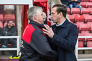 Swindon Town manager Martin Ling shakes hands with his counterpart Justin Edinburgh during the Sky Bet League 1 match between Swindon Town and Gillingham at the County Ground, Swindon, England on 26 December 2015. Photo by Shane Healey.