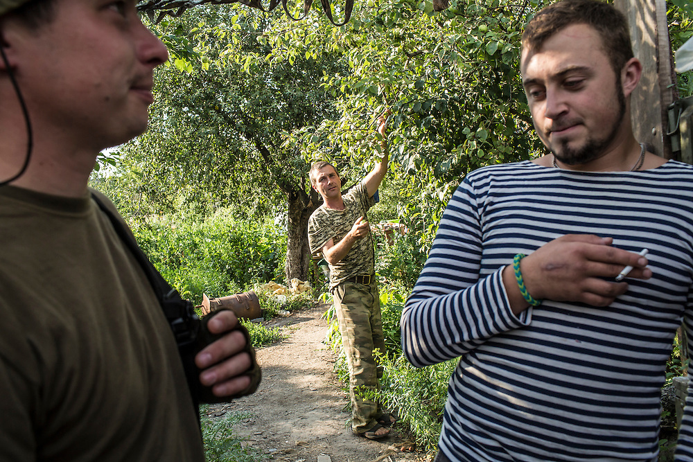 AVDIIVKA, UKRAINE - JULY 9, 2016: Sgt. Ruslan Pilipenko, left, and Pvt. Denis Krylov, right, of the 58th brigade, near the front lines in Avdiivka, Ukraine. The town is now one of the most active areas of fighting along the line of control between the Ukrainian government and Russian-backed rebels. CREDIT: Brendan Hoffman for The New York Times