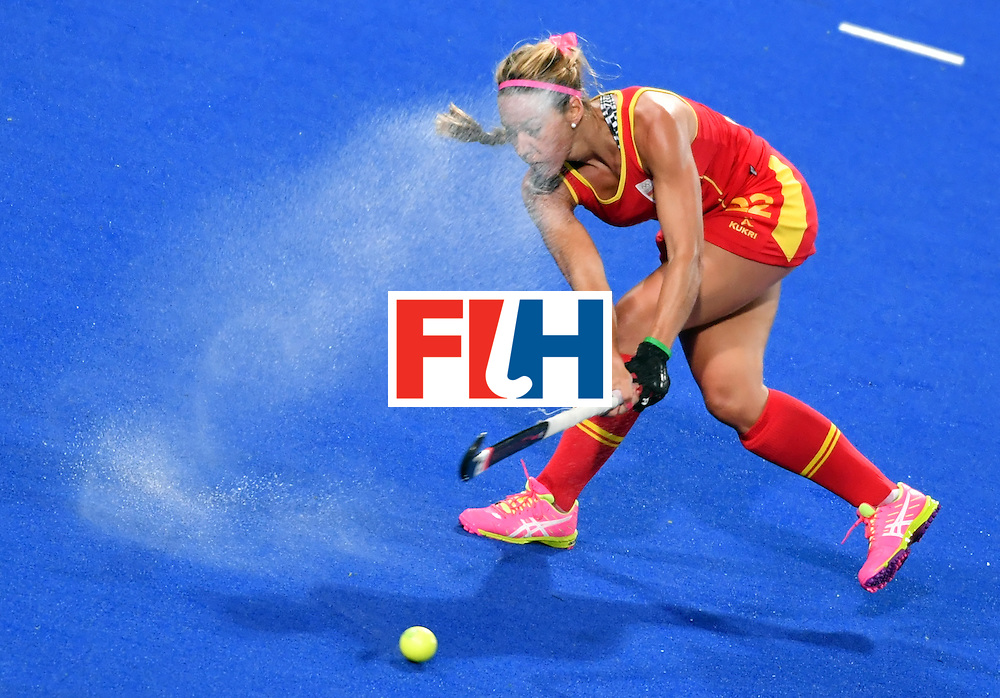 Spain's Gloria Comerma hits the ball during the women's quarterfinal field hockey Britain vs Spain match of the Rio 2016 Olympics Games at the Olympic Hockey Centre in Rio de Janeiro on August 15, 2016. / AFP / Pascal GUYOT        (Photo credit should read PASCAL GUYOT/AFP/Getty Images)