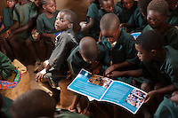 Children of the Chisila Community School supported by PEPAIDS, St Mary's, Monze, Zambia. PEPAIDS is a UK-based NGO whose mission is to promote and preserve the health of people in Zambia through the provision of support for HIV/AIDS initiatives and the promotion of awareness of issues surrounding HIV/AIDS. PEPAIDS' local partner NGO is SAPEP, based in the Monze and Mazabuka districts of the Southern Province of Zambia. They work together to empower the rural youth of Zambia to mobilise their communities to fight poverty and HIV/AIDS. SAPEP works with a large number of AIDS Action clubs (AACs) who are trained by SAPEP project staff in subjects such as peer education approaches; gender, customs and traditions; antiretroviral therapy; and counselling. This training empowers the AACs to support the communities in which they are based in the fight against HIV and AIDS. SAPEP encourages AACs to start income generating activities with the goal of being self-reliant and self-sufficient in their mission to alleviate HIV and AIDS. PEPAIDS has designed its training programme to form a cascade in order to reach as many people as possible. Peer educators participate in Training of Trainers workshops, with skills being passed on to club leaders and club members in turn to benefit the wider community. The entire programme is designed to be sustainable, youth-focused, participatory and culturally acceptable.