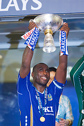 Hong Kong, China - Friday, July 27, 2007: Portsmouth's Sol Campbell lifts the trophy after a penalty shoot-out victory over Liverpool during the final of the Barclays Asia Trophy at the Hong Kong Stadium. (Photo by David Rawcliffe/Propaganda)