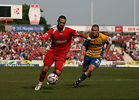 Photo: Rich Eaton.<br /> <br /> Swindon Town v Mansfield Town. Coca Cola League 2. 21/04/2007. Christian Roberts left of Swindon and Callum Lloyd right of Mansfield
