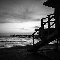 San Clemente lifeguard tower one and San Clemente pier sunset black and white photo. San Clemente California is a beach city in Orange County Southern California Photo is high resolution. Copyright ⓒ 2017 Paul Velgos with All Rights Reserved.