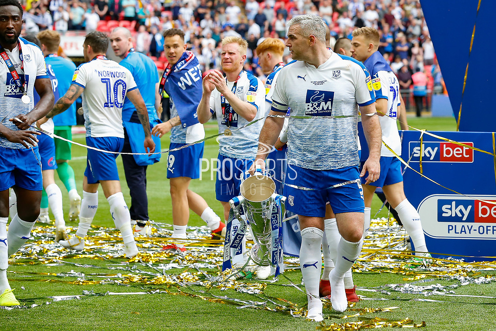PROMOTED promotion Tranmere Rovers players celebrate with the trophy, Tranmere Rovers defender Steve McNulty (5), after the EFL Sky Bet League 2 Play Off Final match between Newport County and Tranmere Rovers at Wembley Stadium, London, England on 25 May 2019.