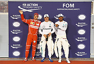 Valtteri Bottas of Mercedes AMG Petronas, with team mate Lewis Hamilton and Sebastian Vettel of Scuderia Ferrari, after winning his maiden pole position during the Bahrain Formula One Grand Prix Qualifying session at the International Circuit, Sakhir<br /> Picture by EXPA Pictures/Focus Images Ltd 07814482222<br /> 15/04/2017<br /> *** UK &amp; IRELAND ONLY ***<br /> <br /> EXPA-EIB-170415-0330.jpg