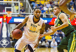 Jan 10, 2017; Morgantown, WV, USA; West Virginia Mountaineers guard Tarik Phillip (12) drives down the lane during the second half against the Baylor Bears at WVU Coliseum. Mandatory Credit: Ben Queen-USA TODAY Sports