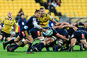 Aaron Smith passes the ball during the super rugby union  game between Hurricanes  and Highlanders, played at Westpac Stadium, Wellington, New Zealand on 24 March 2018.  Hurricanes won 29-12.