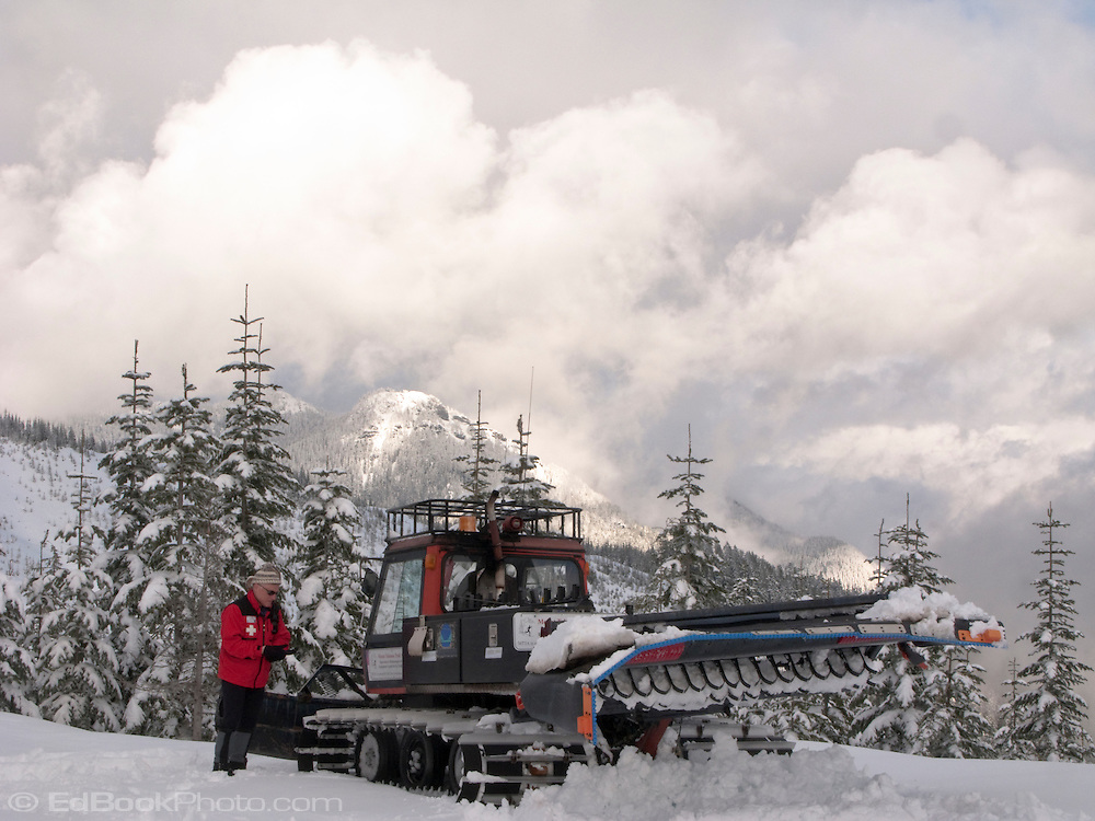 A Mount Tahoma Trails Association ski patroller gets ready to groom the cross country ski trails with a Pisten Bully grooming machine in the Cascade Mountain Range near Mount Rainier, Washington, USA