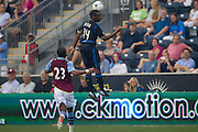 Amobi Okugo of the Philadelphia Union heads the ball as Nathan Delfolineso of Aston Villa  defends during a match between Aston Villa FC and Philadelphia Union at PPL Park in Chester, Pennsylvania, USA on Wednesday July 18, 2012. (photo - Mat Boyle)