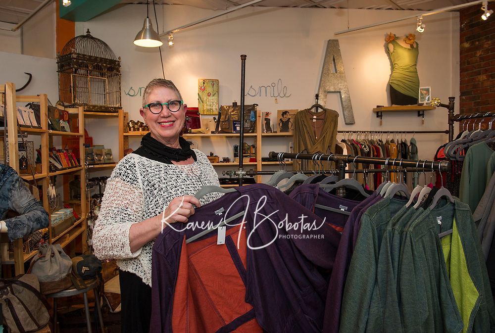 Melissa McCarthy shows off her boutique clothing line in her specialty gift shop The Studio in downtown Laconia.  (Karen Bobotas/for the Laconia Daily Sun)