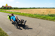 Ligfietsers rijden door de polder bij Schouwen-Duiveland.<br /> <br /> Recumbent cyclists ride at the polder near Schouwen-Duiveland.