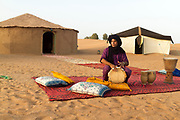 M'HAMID EL GHIZLANE, MOROCCO - 26th April 2014 - Musician plays drums at a camp in the Erg Chigaga region of the Moroccan Sahara, beyond M'Hamid el Ghizlane, Erg Chigaga, Southern Morocco.