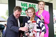 Miss Sophie Dods celebrates winning The Queen Mothers Cup (for Lady Amateur Riders) over 1m 4f (£20,000) with her weight in champagne and is joined by her sister Chloe Dods (Pink Lady)  during the Macmillan Charity Raceday at York Racecourse, York, United Kingdom on 16 June 2018. Picture by Mick Atkins.