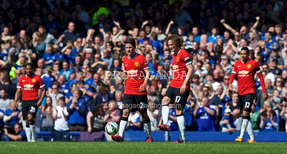 LIVERPOOL, ENGLAND - Sunday, April 26, 2015: Manchester United's Ander Herrera, Daley Blind and Chris Smalling look dejected as Everton score the third goalo during the Premier League match at Goodison Park. (Pic by David Rawcliffe/Propaganda)