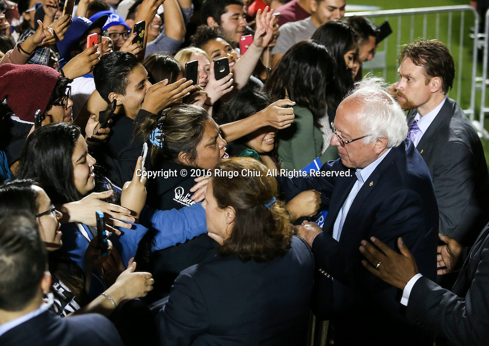 Democratic presidential candidate Bernie Sanders greets supporters after speaking at a rally at Ganesha High School Stadium in Pomona Calif., on May 26, 2016.(Photo by Ringo Chiu/PHOTOFORMULA.com)<br /> <br /> Usage Notes: This content is intended for editorial use only. For other uses, additional clearances may be required.
