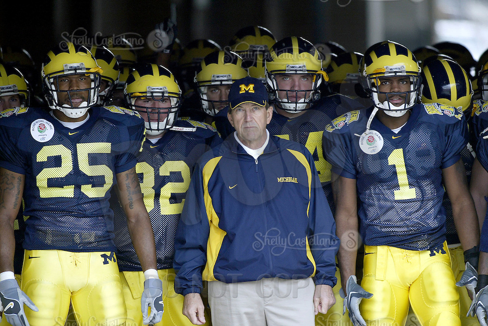 1 January 2005: Big-10 Michigan Wolverine head coach Lloyd Carr enters the field with players Ernest Shazor #25 Kevin Dudley #32 and Braylon Edwards #1 before a 37-38 loss against the Texas Longhorn the Rose Bowl Stadium Pasadena, CA.